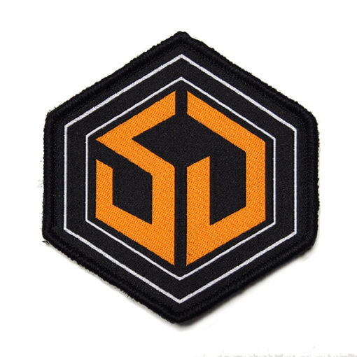 orange and black woven survival dispatch backpack patch on white background