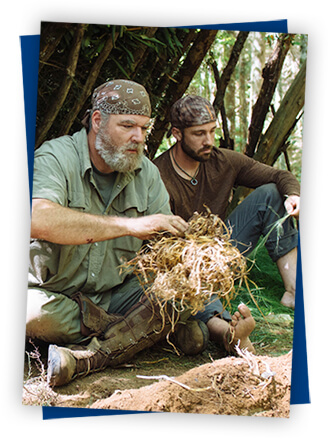 bushcraft expert starting a fire with another guy-4